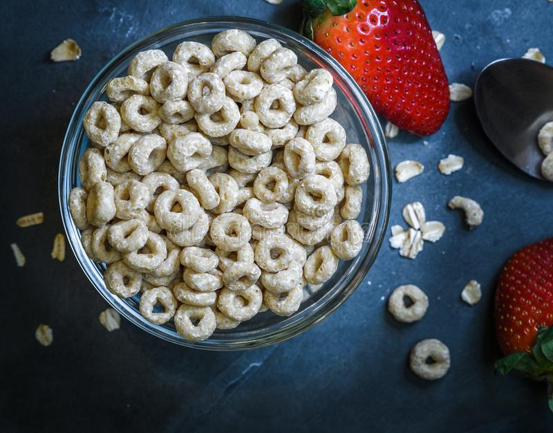 Breakfast made up of dry cereal with red strawberries stock images