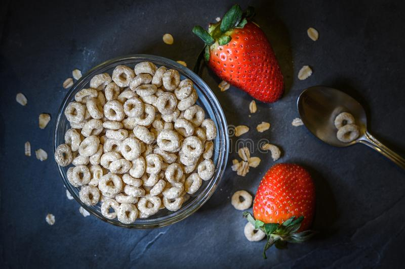 Breakfast made up of dry cereal with red strawberries royalty free stock photography