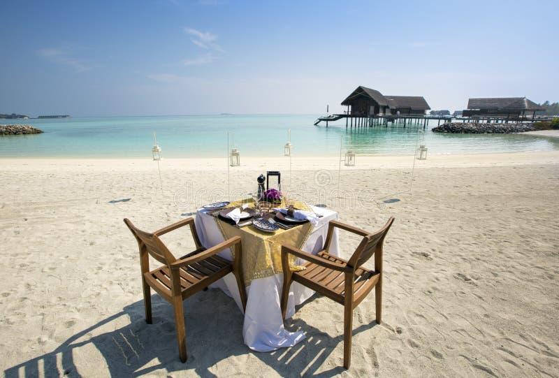 Breakfast at Maldives setup on the beach royalty free stock photos