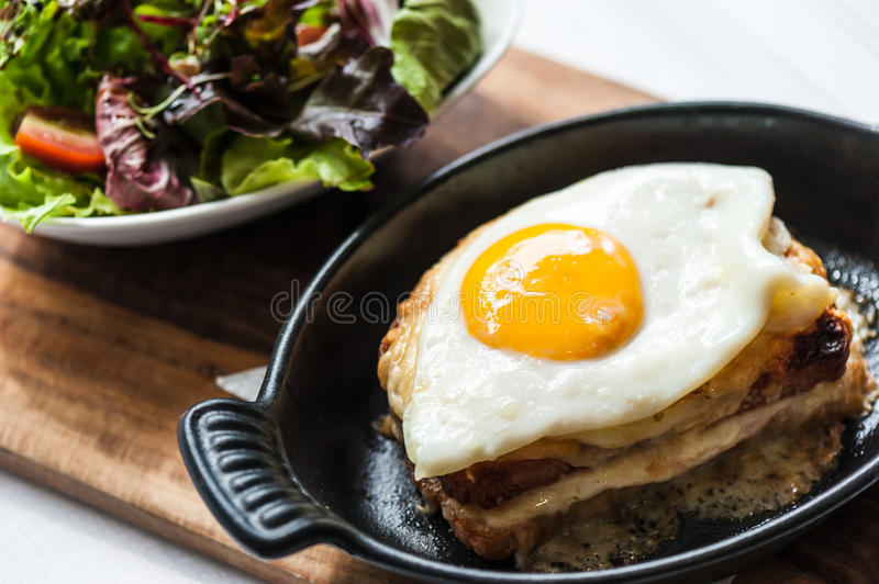 Breakfast menu with beautiful fried eggs and bread. Breakfast menu with beautiful fried eggs, bread and ham royalty free stock photos