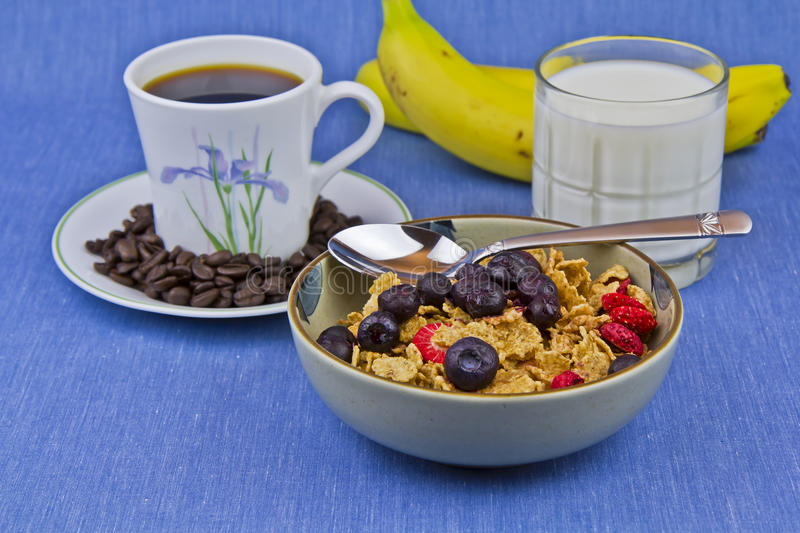 Breakfast, milk, banan, cereal, coffee and bowl royalty free stock photos