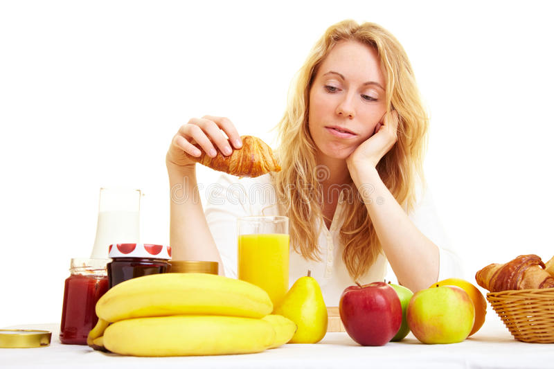 Breakfast in the morning. Woman in the morning at the breakfast table stock image