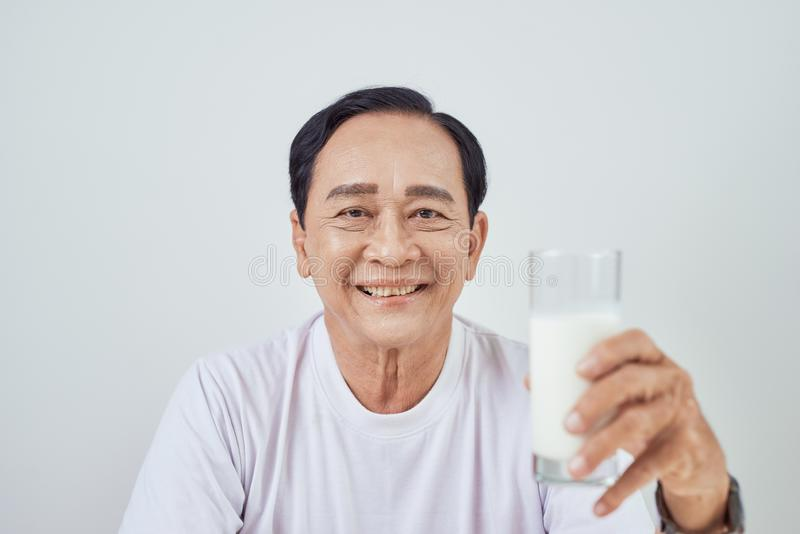 Breakfast at morning. Elder person holding  glass of milk. Healthy food.  royalty free stock image