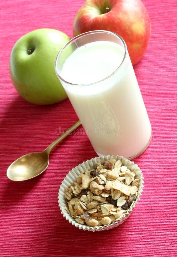 Breakfast, muesli apple and glass of milk