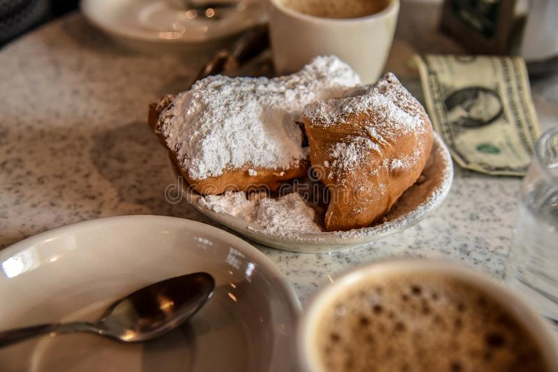 Breakfast in New Orleans USA. Beignet is a pastry of French influence typical from New Orleans royalty free stock photography