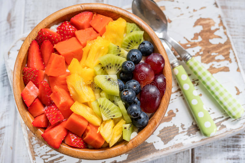 Breakfast oatmeal for kids topped with rainbow fruits. Healthy eating breakfast oatmeal for kids topped with rainbow fruits royalty free stock photo