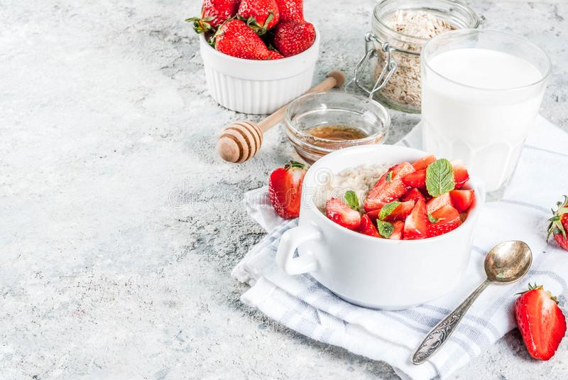 Breakfast oatmeal with strawberry royalty free stock photography
