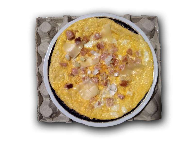 Eggs, ham and cheese. Breakfast. Omelet with eggs, ham and cheese and onion, served on a plate, and plate is on cartoon for eggs, isolated on a white stock image