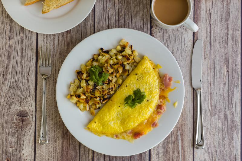 Breakfast Omelette and Hashbrowns stock photo