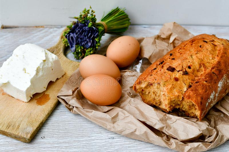 cheese, milk, bread and eggs stock images