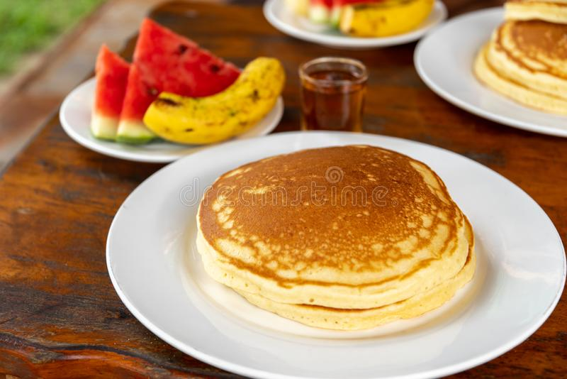 Breakfast Pancake with syrup and Fruits royalty free stock images