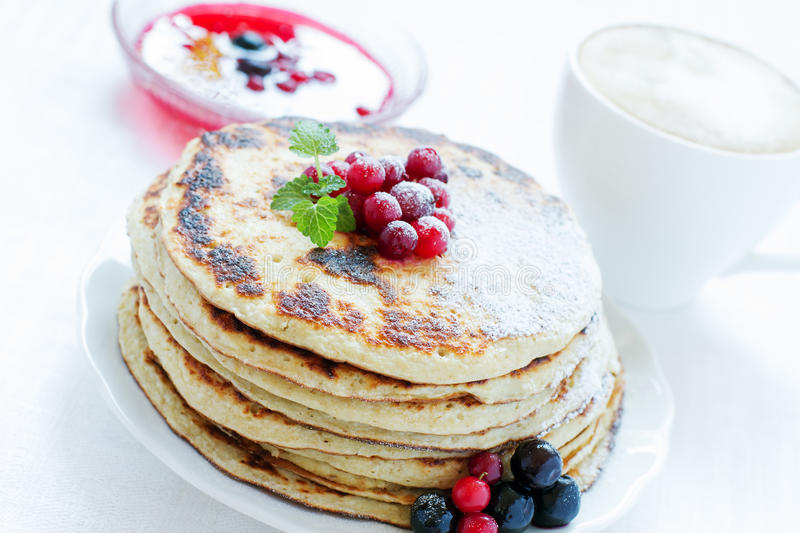 Pile of pancakes with berries