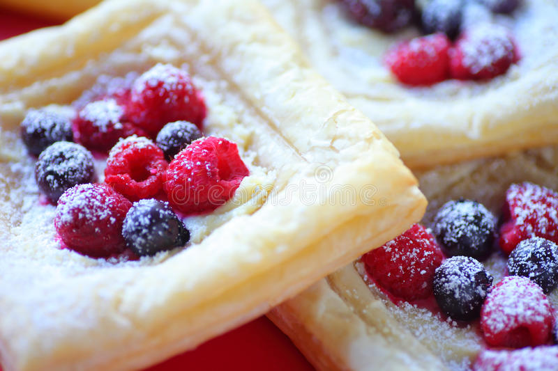 Breakfast pastries with fresh fruit royalty free stock images