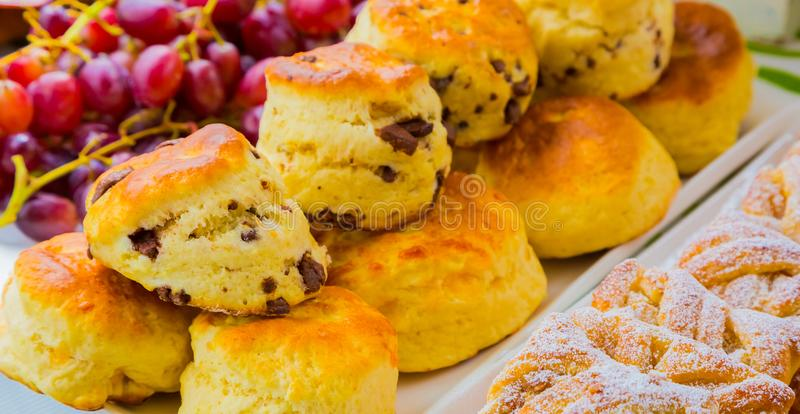 Breakfast pastry muffin at Spring Festival picnic event. Breakfast Danish pastry and scone - Danish pastry and chocolate chip scone for catering at Spring royalty free stock photo