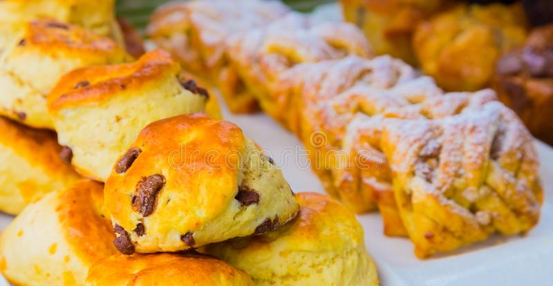 Breakfast pastry scone muffin at Spring Festival picnic event. Breakfast Danish pastry and scone - Danish pastry and chocolate chip scone for catering at Spring stock image