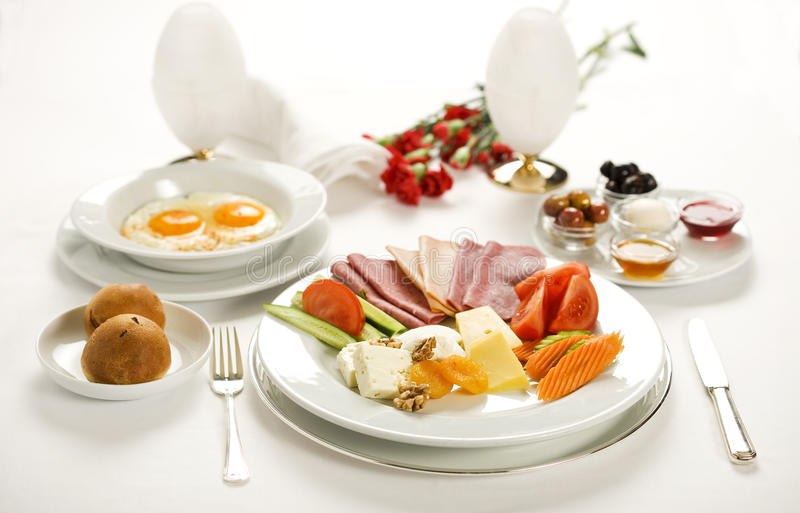Breakfast plate. Turkish breakfast with egg, olive, cheese, salami and marmalada stock images