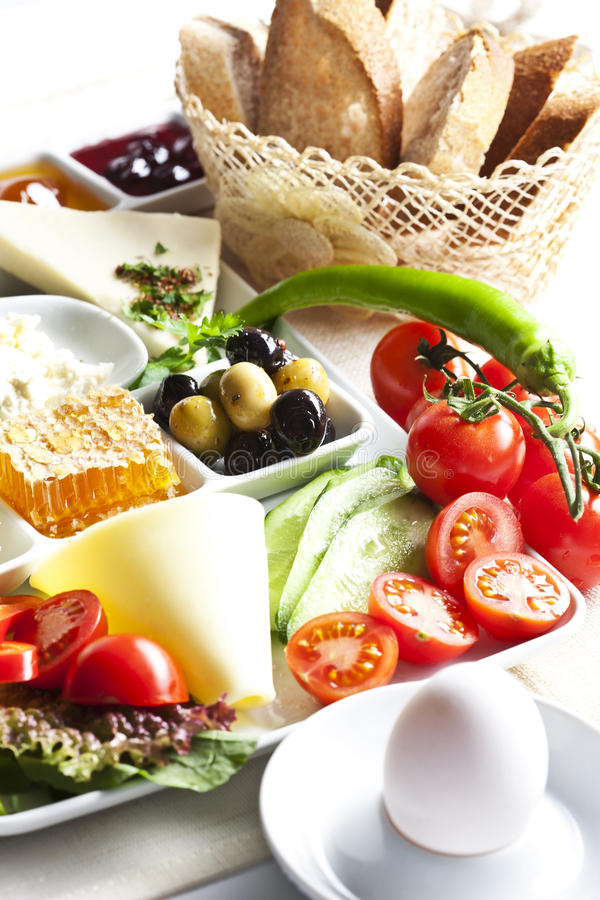 Breakfast plate. With egg, olive, cheese and honey royalty free stock photography