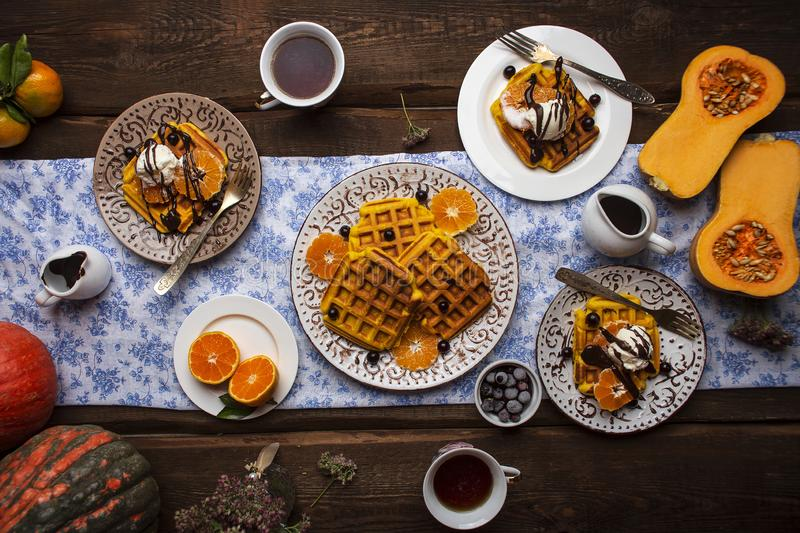 Breakfast with pumpkin waffles and ice cream royalty free stock image