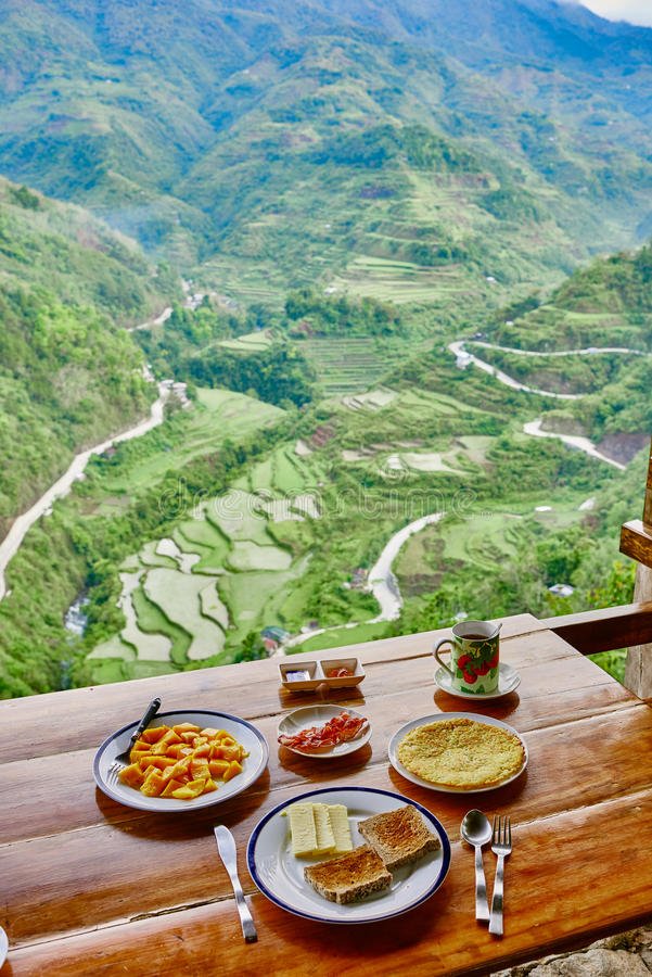 Breakfast rice paddy terrace fields Philippines. Breakfast rice paddy terrace fields between banaue and batad infugao Luzon in Philippines stock image