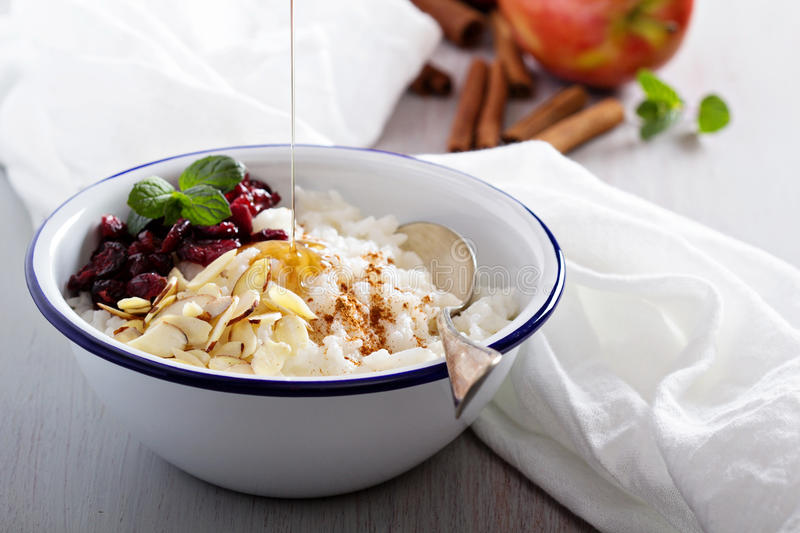 Breakfast rice porridge with almonds and cranberry royalty free stock photo