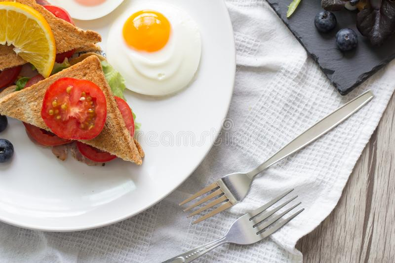 Breakfast. Sandwich with ham and tomatoes on plate royalty free stock photography