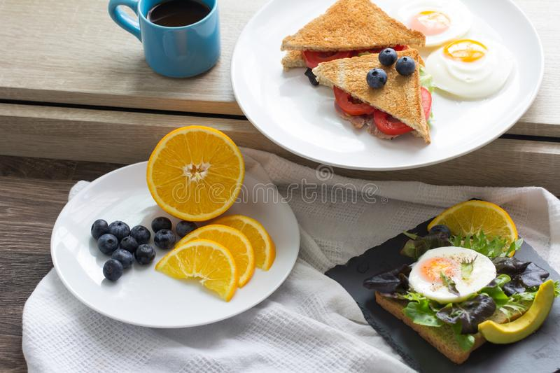 Breakfast. Sandwich with ham and tomatoes on plate stock photos
