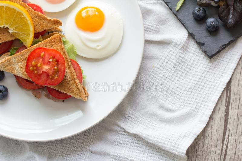 Breakfast. Sandwich with ham and tomatoes on plate stock image