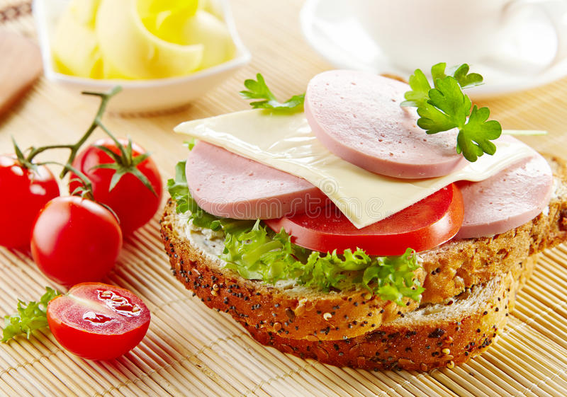 Breakfast sandwich with sliced sausage and tomato stock photo