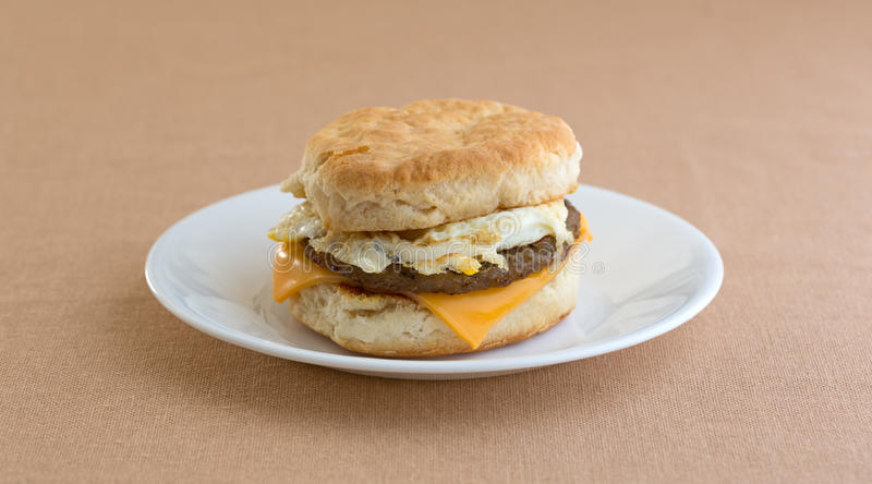 Breakfast sausage egg and cheese biscuit on plate stock photos