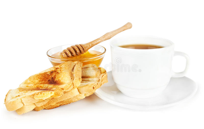 Breakfast scene. Honey, toasts and tea stock images