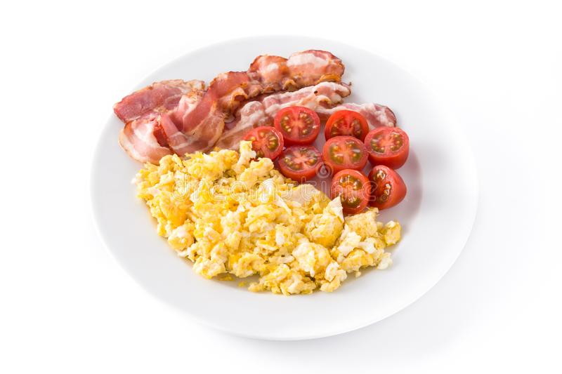 Breakfast with scrambled eggs, bacon and tomatoes isolated royalty free stock photos