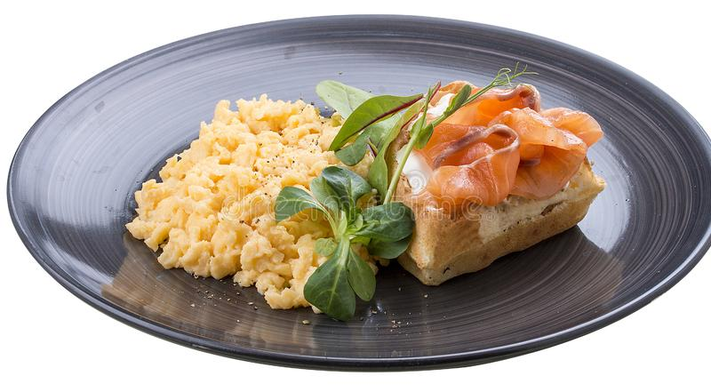 Breakfast. Scrambled eggs with salmon stock image