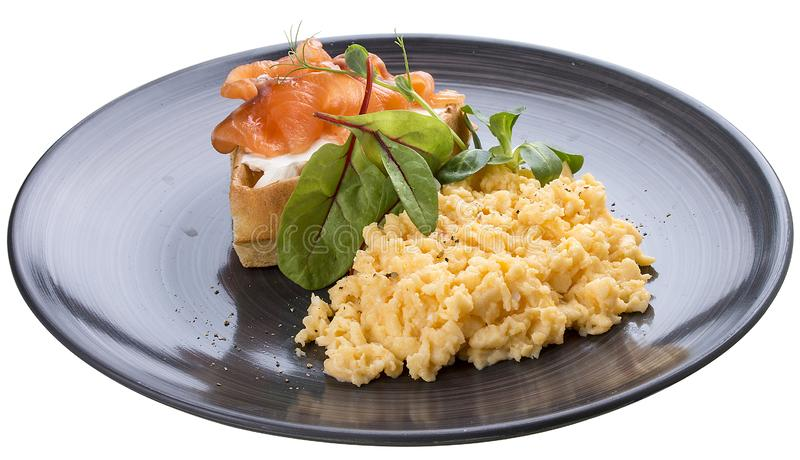 Breakfast. Scrambled eggs with salmon royalty free stock image