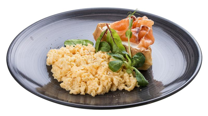 Breakfast. Scrambled eggs with salmon stock images