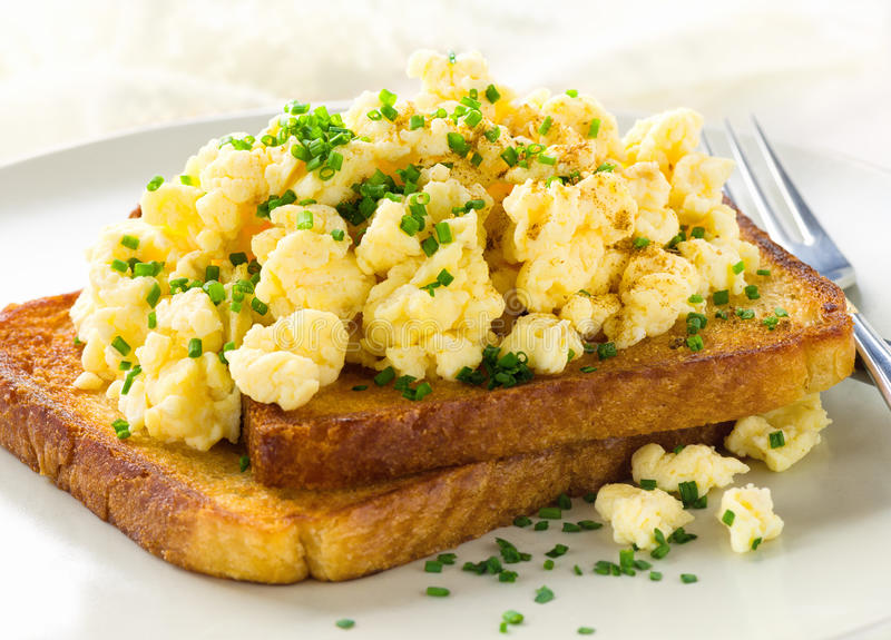 Breakfast with scrambled eggs stock images