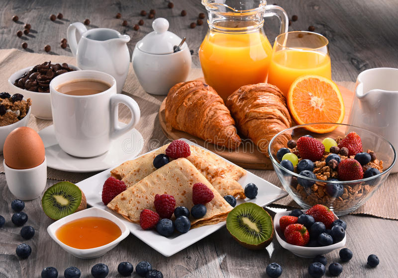 Breakfast served with coffee, juice, croissants and fruits royalty free stock photos