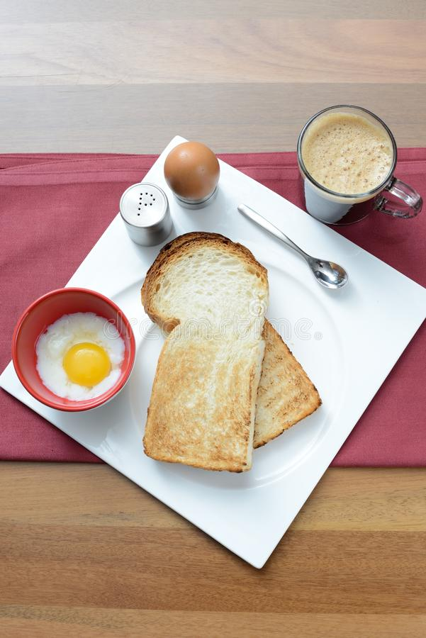 Free Breakfast Set Consisting Toast Bread And Half-boiled Egg Royalty Free Stock Photo - 64486695