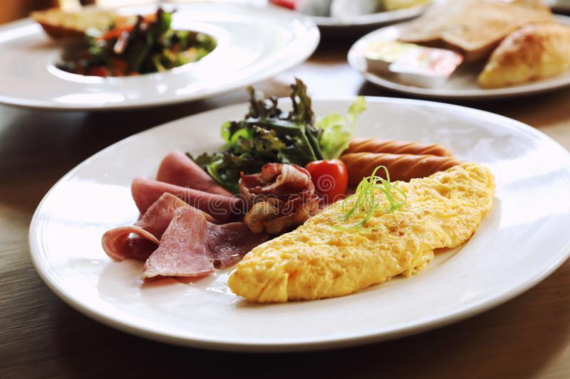 Breakfast set Omelette with sausage bacon and salad. In close up royalty free stock photos