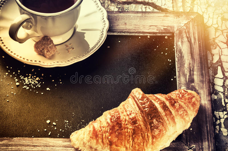 Breakfast setting with coffee cup and croissant. Menu concept ba stock images