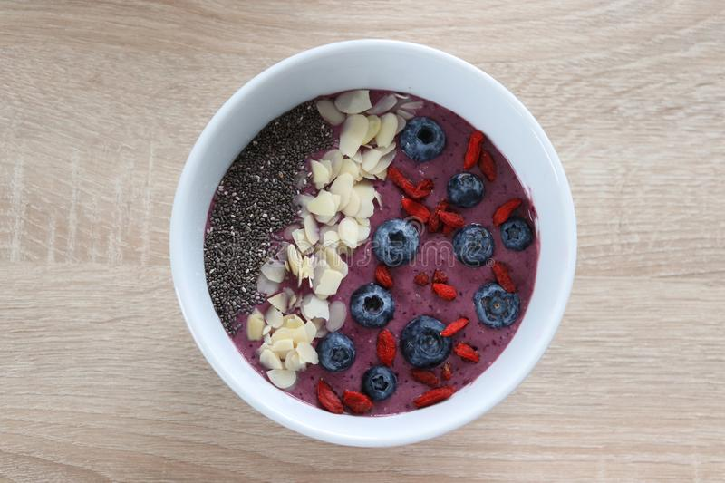 Breakfast smoothhie bowl with berries royalty free stock images