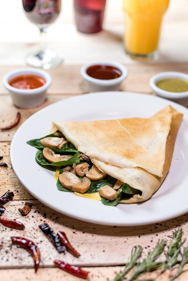 Mushroom crepe snack. Breakfast snack mushroom crepe dish stock images
