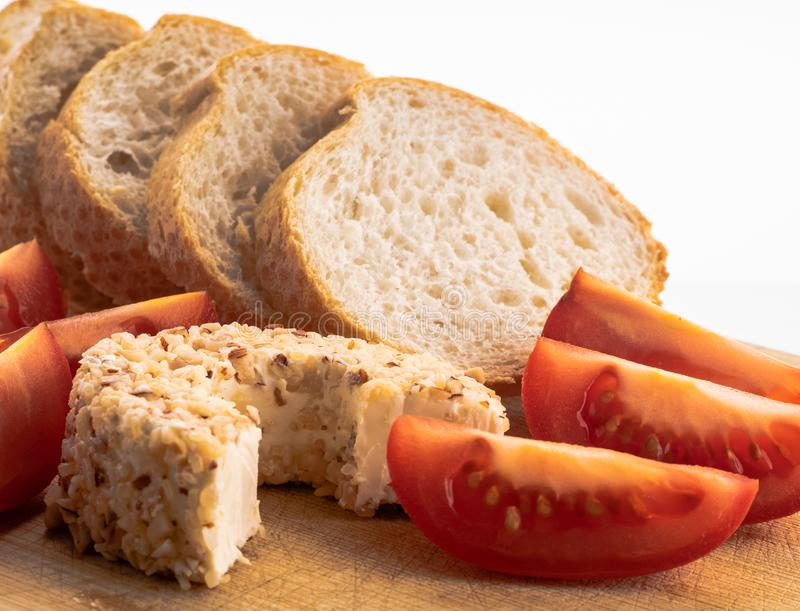 Breakfast with soft cheese, fresh baguette and tomatoes stock image
