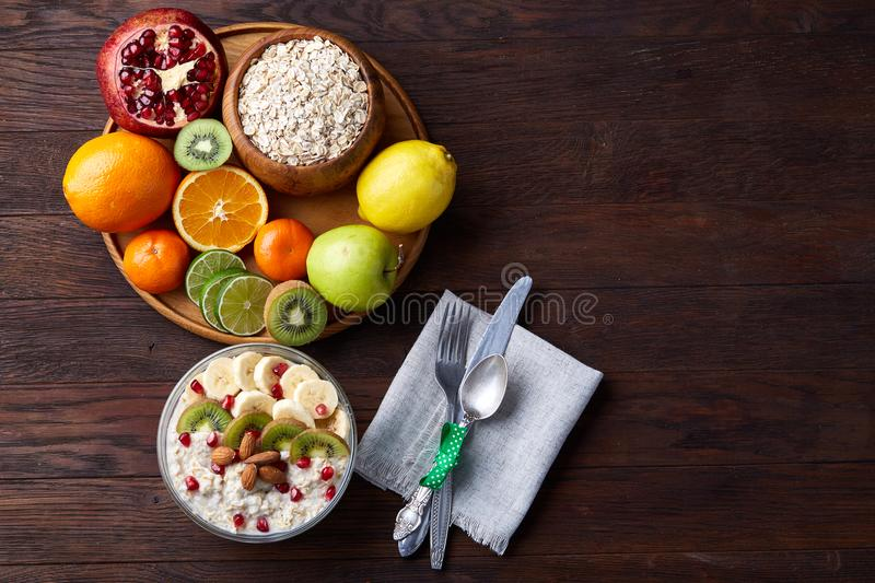 Breakfast still life with oatmeal porridge and fruits, top view, selective focus, shallow depth of field. royalty free stock photography