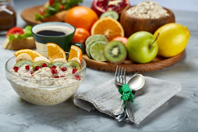 Breakfast still life with oatmeal porridge and fruits, top view, selective focus, shallow depth of field. royalty free stock photo