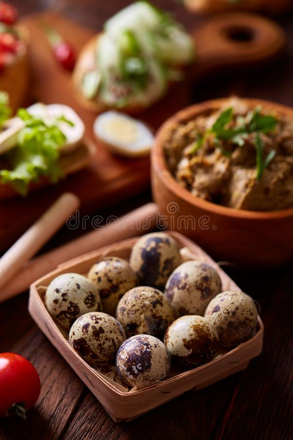 Breakfast still life with sandwiches, quail eggs, spicies and fresh fruits and vegetables, selective focus royalty free stock photos