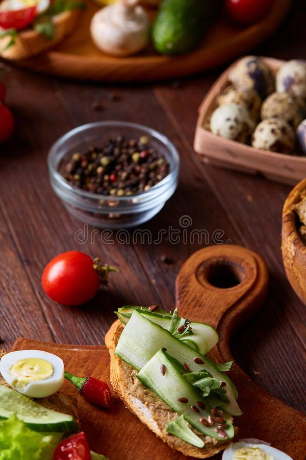 Breakfast still life with sandwiches, quail eggs, spicies and fresh fruits and vegetables, selective focus stock photos