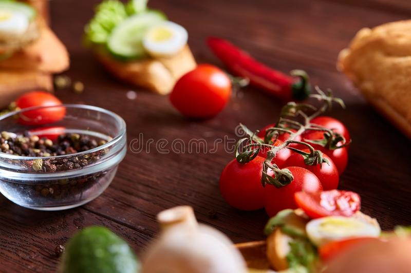 Breakfast still life with sandwiches, quail eggs, spicies and fresh fruits and vegetables, selective focus royalty free stock photo