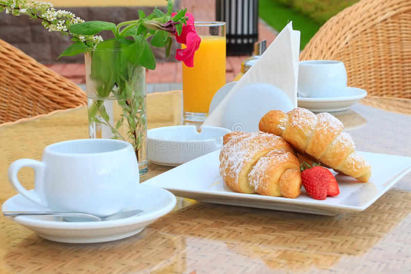 Breakfast on a sunny morning. Outdoor royalty free stock photos