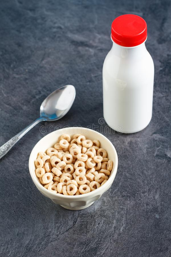 Breakfast with sweet cereal rings and milk royalty free stock photos