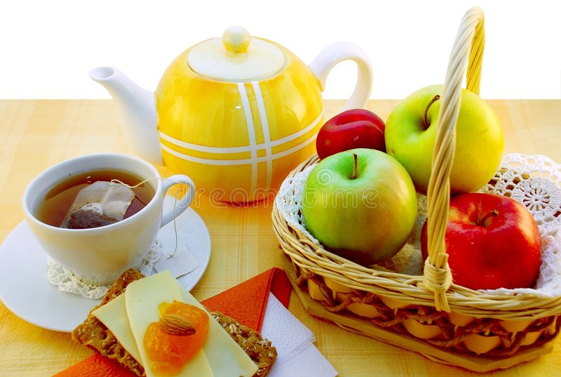 Breakfast table. Colorful inviting breakfast table with fruits stock images